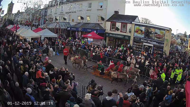 image of a screenshot taken from the webcam in Keswick of Santa on his sleigh, pulled by reindeer, arriving at the Victorian Fayre in Keswick Market Square