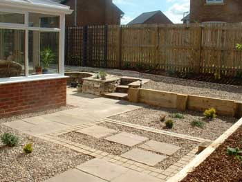 image of a gravel and sandstone low maintenance garden created by Dave Bell gardening services