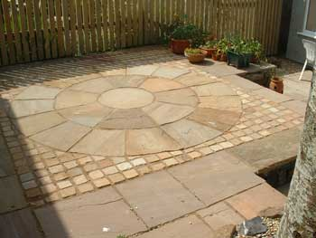 image of an Indian sandstone patio created by Dave Bell gardening and landscaping services