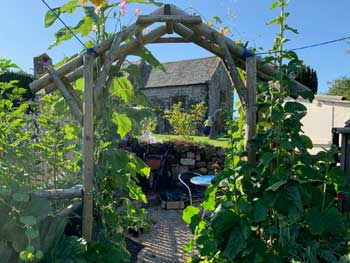image of a rustic arch in a Cockermouth garden
