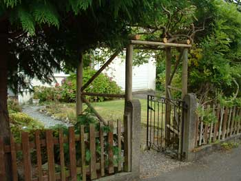 image of a supporting arch and wisteria created by David Bell Keswick Garden Tidy Ups service