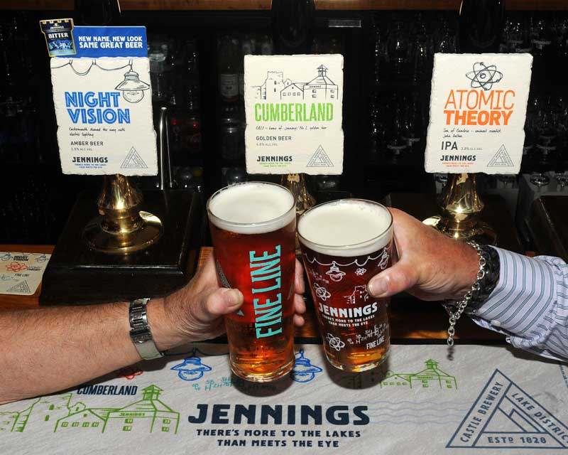 image of two pints of Jennings beer at the brewery