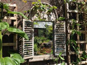 image of a mirror in a garden created by David Bell Cockermouth garden tidy ups services
