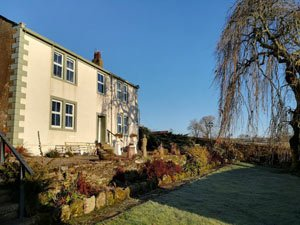 image of Ullock Mains self catering large holiday cottage for group accommodation in the lake district