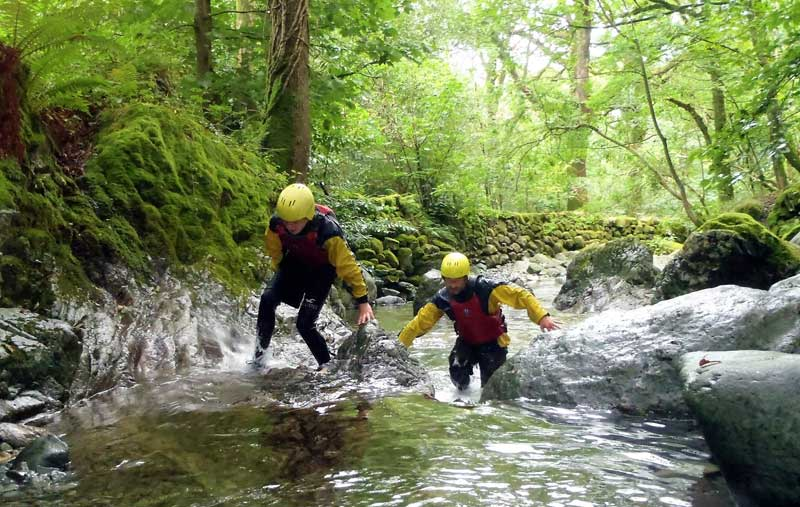 image of two people ghyll scrambling in the Lake District as it reopens after coronavirus lockdown