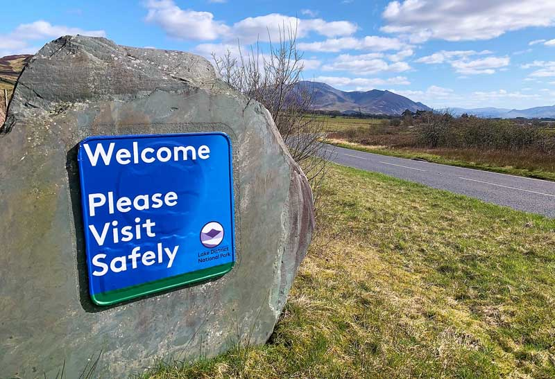 image of a Lake District National Park sign near Bassenthwaite reading Welcome please visit safely