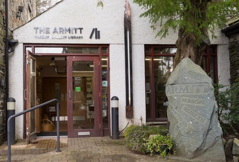 Image of the Armitt museum in the town of Ambleside, image shows the entrance of the museum with tree in the foreground